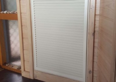 Customised, coloured, low level, half chevron, return air grilles installed for a commercial client in Glen Osmond