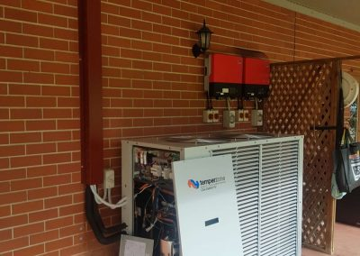 Large Scale residential Installation Temperzone 29Kw Outdoor Unit with custom Colour bond pipe capping Onkaparing hills